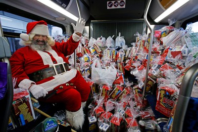 Santa is onboard and asking for everyone for food donators during this year's TS Stuff A Bus campaign. This year's goal is to fill 15 buses with non-perishable food for Edmonton's Food Bank. Friday's locations to make a donation is at the Save-On-Foods at 3361 Calgary Trail from 8am - 7pm. Tom Braid/Edmonton Sun/QMI Agency