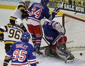 Kingston Frontenacs Spencer Watson, left, and Ryan Kujawinski watch the puck go behind Kitchener Rangers goalie Dawson Carty as Justin Bailey and Max Iafrate look on during Ontario Hockey League action at the Rogers K-Rock Centre on Friday night. (Ian MacAlpine/The Whig-Standard)