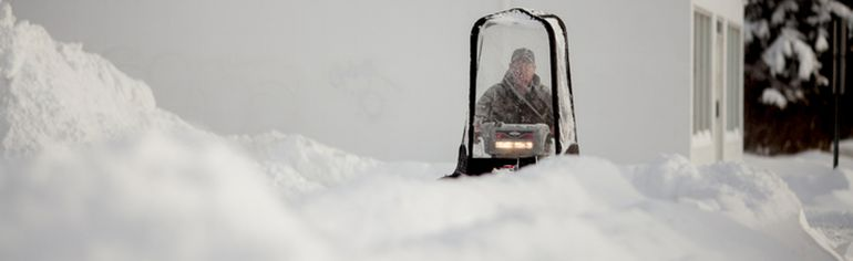 A worker clears snow from a sidewalk on November 28, 2014 in downtown Whitecourt, Alta. In less than 24-hours, 43 cm of snow fell breaking previous historical records for most snowfall in a day (previously 5.2 cm, recorded in 2001) and most snow accumulation by this date (previously 30.6 cm, recorded in 1996, according to Environment Canada's records starting in 1978. Adam Dietrich | Whitecourt Star