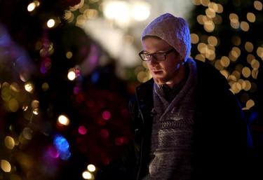 James Acheson looks at the Christmas Trees on display during the final day of the Festival of Trees at the Shaw Conference Centre, in Edmonton Alta., on Sunday Nov. 30, 2014. David Bloom/Edmonton Sun/QMI Agency