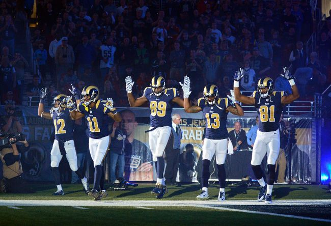 Rams players Stedman Bailey (12), Tavon Austin (11), Jared Cook (89), Chris Givens (13), and Kenny Britt (81) put their hands up to show support for Michael Brown before a game against the Raiders in St. Louis on Sunday, Nov. 30, 2014. (Jeff Curry/USA TODAY Sports)
