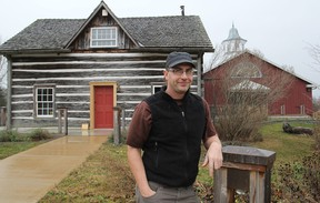 Curator Tom Riddolls stands in front of the MacLachlan Woodworking Museum, at Grass Creek Park, which will be holding its annual WinterLight celebration. (Michael Lea/The Whig-Standard)