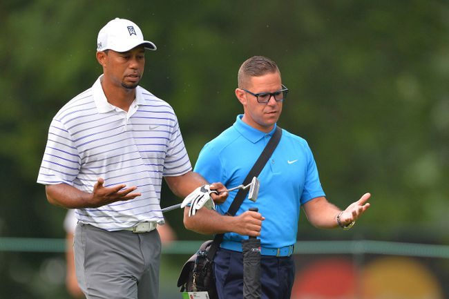Tiger Woods talks with swing coach Sean Foley on the 10th fairway at Congressional Country Club during the practice round of the 2014 Quicken Loans National.. (Tommy Gilligan/USA TODAY Sports)