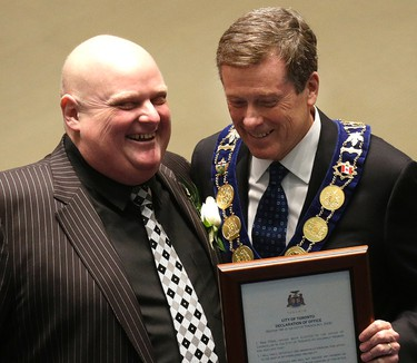Councillor Rob Ford gets his declaration of office from Mayor John Tory during the swearing-in ceremony Tuesday December 2, 2014. (Craig Robertson/Toronto Sun)