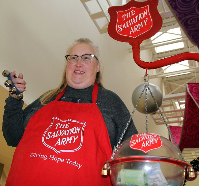 Caroline Dukes helps Salvation Army collect donations Tuesday, Dec. 2, 2014 at Station Mall in Sault Ste. Marie, Ont.
