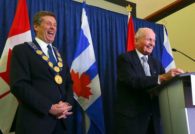 Mayor John Tory laughs with former premier Bill Davis after the first council meeting at Toronto City Hall in Toronto on Tuesday December 2, 2014. (Dave Abel/Toronto Sun)