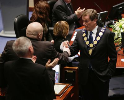 Mayor John Tory shakes hands with Councillor Rob Ford during the first council meeting of the term at City Hall on Tuesday December 2, 2014. (Craig Robertson/Toronto Sun)