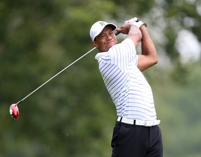 Tiger Woods tees off on the 5th hole during the second round of the 2014 PGA Championship golf tournament at Valhalla Golf Club on Aug 8, 2014. Brian Spurlock-USA TODAY Sports