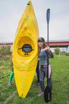 Japanese artist Megumi Igarashi, known as Rokudenashiko, poses with her kayak modeled on her vagina at the Tama river in Tokyo in this October 19, 2013 picture provided by Eigo Shimojo.  REUTERS/Eigo Shimojo/Handout via Reuters