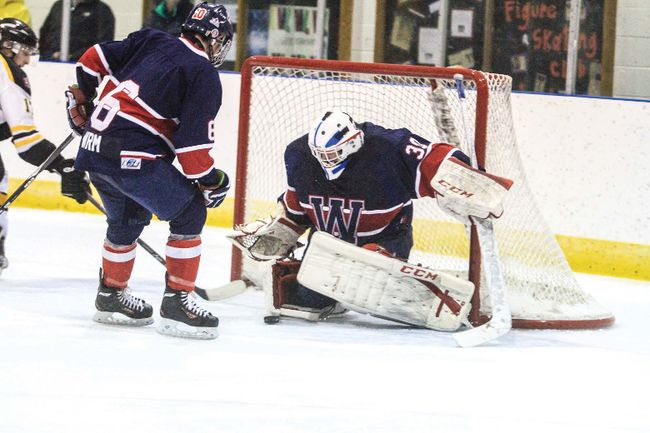 New goalie Ben Dennis makes a save during last Sunday�s games against the Beaumont Chiefs.