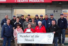 The staff of Gerry's Enterprises pose with Cochrane Board of Trade after being chosen as Member of the Month.