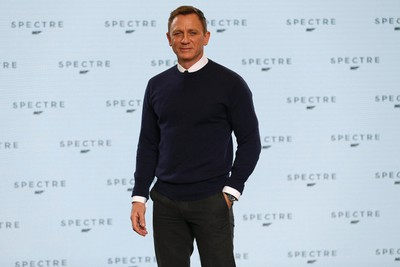 """Actor Daniel Craig poses on stage during an event to mark the start of production for the new James Bond film """"Spectre"""", at Pinewood Studios in Iver Heath, southern England December 4, 2014.   REUTERS/Stefan Wermuth"""
