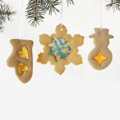 "Stained Glass Holiday CookiesA family-friendly recipe that adds ""wow"" to the classic sugar cookie.INGREDIENTS:- 1 cup (250 ml) granulated sugar- 3/4 cup (175 ml) butter, softened- 1 egg- 1 tsp (5 ml) vanilla extract- 2 1/2 cups (625 ml) all-purpose flour (approx.)- 1/2 tsp (2 ml) baking powder- Pinch salt- 1 box (128 g) coarsely crushed Allan Fruit Buddies (hard candy), any flavour, (approx.)DIRECTIONS:Beat sugar with butter, on medium speed, until light and fluffy. Beat in egg and vanilla until incorporated. Stir flour with baking powder and salt. Mix dry mixture into butter mixture, in two additions, just until combined. Knead dough lightly until smooth. Divide dough into two equal portions and form into disks. Wrap disks in plastic wrap; chill for 30 minutes.Preheat oven to 375F (190C). Roll dough out, on a lightly floured surface, 1/4-inch (5 mm) thick. Use holiday cookie cutters to cut out cookies. Arrange cookies, at least 1-inch (2.5 cm) apart, on parchment-lined baking sheets. Use smaller cutters or a paring knife to cut out shapes from centres of cookies (leave at least 1/4-inch (5 mm) borders around interior shapes).Fill cut-outs with candy pieces. (Don't overfill, small gaps will fill in when candy melts.) If desired, poke a small hole at top of each cookie, so cookies can be strung and hung as decorations. Re-roll scraps to make more cookies.Bake for 8 to 10 minutes or until golden around edges and candy centres are evenly melted. Cool cookies completely on baking sheet before lifting to allow centres to set. Cookies can be stored in an airtight container for up to five days.Makes about three dozen cookies (using 3-inch/8 cm cutters).TIP: Crush a variety of Allan Fruit Buddies to get different coloured centres, just be sure to keep flavours separate."