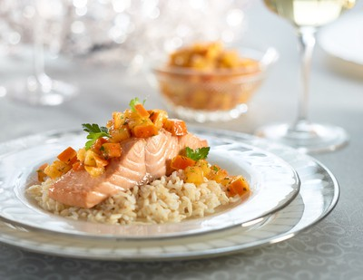 Poached Salmon with Persimon Lime SalsaPoaching the salmon allows an infusion of flavour and renders a moist piece of fish. This salsa adds kick.INGREDIENTS:- 1 cup (250 ml) vegetable or fish stock- 1 cup (250 ml) water- 1/2 (125 ml) cup white wine- 1/4 cup (60 ml) soy sauce- 4 slices ginger- 4 (24 oz/750 g total) salmon filets- 2 cups (500 ml) cooked brown ricePersimon Lime Salsa:- 1 Persimon, finely diced- 2 Tbsp. (30 ml) lime juice- 2 Tbsp. (30 ml) finely chopped parsley- 1 tsp. (5 ml) lime zest- 1 tsp. (5 ml) olive oil- 1/2 tsp. (2 ml) chili sauce- 1/2 tsp. (2 ml) grated gingerDIRECTIONS:In a large deep skillet, combine stock, water, wine, soy sauce and ginger and bring to a simmer. Add salmon and cover, reducing heat to low. Poach salmon for 10 minutes turning once until cooked through. Serve with salsa and brown rice.For salsa, combine Persimon, lime juice, parsley, zest, oil, chili sauce and ginger.Makes 4 servings.