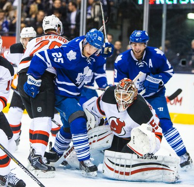 Toronto Maple Leafs Mike Santorelli and New Jersey Devils during 1st period action at the Air Canada Centre in Toronto on Thursday December 4, 2014. Ernest Doroszuk/Toronto Sun/QMI Agency