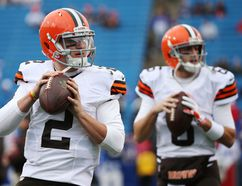 Johnny Manziel (left) will watch fellow quarterback Brian Hoyer from the sideline — at least to start the game — at home on Sunday against the Colts. (AFP)