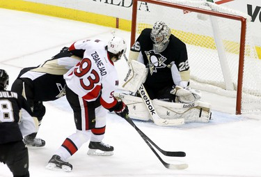 Dec 6, 2014; Pittsburgh, PA, USA; Ottawa Senators center Mika Zibanejad (93) scores past Pittsburgh Penguins goalie Marc-Andre Fleury (29) during the second period at the CONSOL Energy Center. Mandatory Credit: Charles LeClaire-USA TODAY Sports