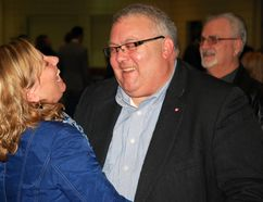 Karen Vecchio, left, shares a laugh with Elgin-Middlesex-London MP Joe Preston at St. Joseph's Catholic High School in St. Thomas, Ont. on Saturday, Dec. 6, 2014. Vecchio is Preston's long-time assistant and had just learned she will succeed Preston as the riding's federal Conservative nominee.Ben Forrest/Times-Journal