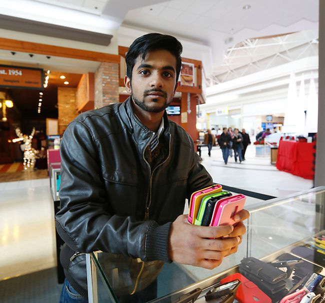 Ahsen Qurshei,  who runs a phone accessories store at Eglinton Square mall, says sales are going strong. (MICHAEL PEAKE, Toronto Sun)
