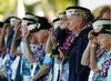Louis Conter (3rd R in blue jacket), a USS Arizona survivor, and other Pearl Harbor survivors salute as the USS Chung-Hoon passes by during ceremonies honoring the 73rd anniversary of the attack on Pearl Harbor at the World War II Valor in the Pacific National Monument in Honolulu, Hawaii December 7, 2014. More than 50 World War Two veterans will gather in Honolulu on Sunday to commemorate the 73rd anniversary of the Japanese attack on Pearl Harbor that left more than 2,000 Americans dead and thrust the United States into the war. REUTERS/Hugh Gentry