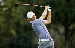 Jordan Spieth hits his tee shot on the third hole during the final round of the Hero World Challenge at the Isleworth Golf & Country Club on December 7, 2014 in Windermere, Florida. (Scott Halleran/Getty Images/AFP)