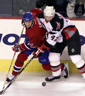 Montreal Canadien winger Brian Savage (left) battles for puck with Buffalo Sabre defenceman Richard Smehlik (42) on Nov. 3, 2000, at the HSBC Arena in Buffalo, N.Y. The Sudbury native was in town on the weekend for the Hometown Hockey festivities.