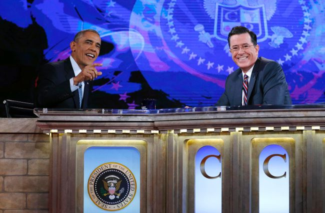 U.S. President Barack Obama, left, appears on The Colbert Report with Stephen Colbert at the Lisner Auditorium at George Washington University in Washington on December 8,  2014. (REUTERS/Kevin Lamarque)