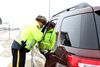A member of the RCMP speaks with a driver during a Checkstop along Highway 59 earlier this month. (Brook Jones/QMI Agency file photo)