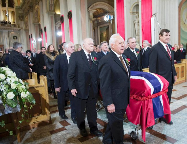 Pallbearers and former teammates (L-R) Jean-Guy Talbot, Phil Goyette, Yvan Cournoyer, Guy Lafleur and Serge Savard carry the casket of former Montreal Canadiens captain Jean Beliveau at Mary Queen of the World Cathedral in Montreal, December 10, 2014.