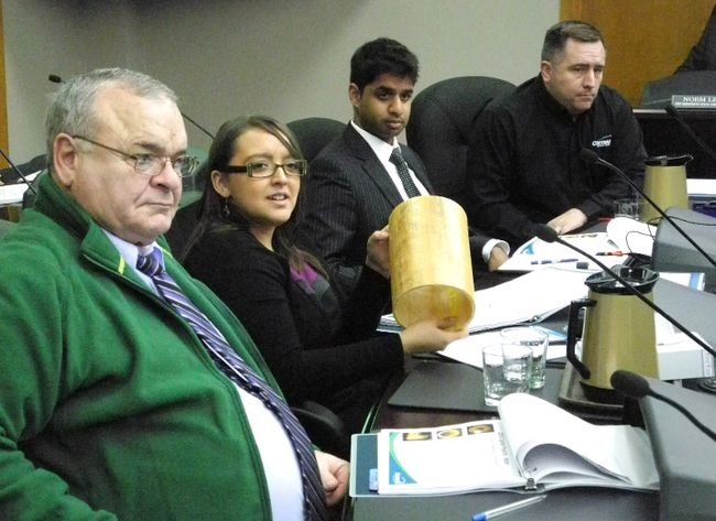 <p>From left, Cornwall councillors Andre Rivette, Carilyn Hebert, Justin Towndale and David Murphy took turns examining a water pipe lining during the special council meeting to pass the water and sewer budget on Wednesday.</p><p>GREG PEERENBOOM/CORNWALL STANDARD-FREEHOLDER/QMI AGENCY