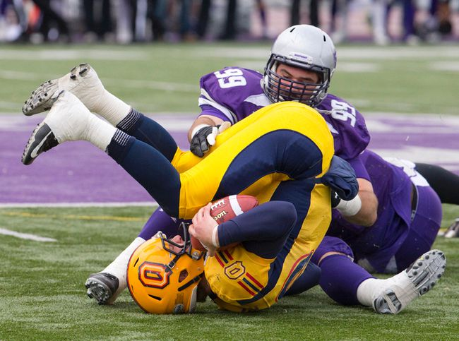 Western Mustangs defensive lineman Daryl Waud, seen here sacking Queen's Golden Gaels QB Billy McPhee, is third in the latest CFL draft rankings. (Craig Glover, QMI Agency)