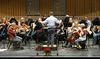 Members of Orchestra London rehearse at Centennial Hall. (Free Press file photo)