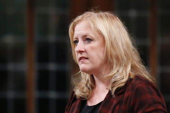 Canada's Transport Minister Lisa Raitt speaks during Question Period in the House of Commons on Parliament Hill in Ottawa, Oct. 7, 2014. (CHRIS WATTIE/Reuters)
