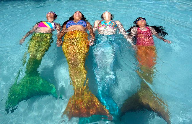 An instructor (second from the left) from the Philippine Mermaid Swimming Academy assists participants of a monofin swimming summer workshop as they practise floating in the water. A London woman who works in Sarnia wants to eventually enroll in the class.