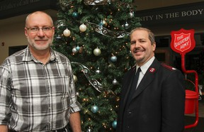 Ed Peterson, left, Salvation Army Christmas campaign co-ordinator, and Salvation Army Major David McNeilly are looking to the public for help with this year's Jerome Taylor Memorial Whig-Standard/Salvation Army Christmas Hamper Fund. (Julia McKay/The Whig-Standard)