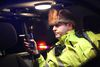 Airdrie, Alta. - Cpl. Darren Turnbull with a breathalyzer in his vehicle as Airdrie RCMP and Calgary Police hold a check stop along Township Road 566 in Balzac on Friday, Dec. 5, 2014. BRITTON LEDINGHAM / AIRDRIE ECHO