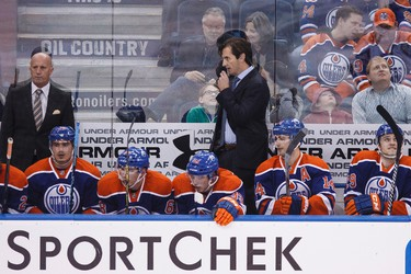 Edmonton head coach Dallas Eakins speaks on a remote link during the second period of a NHL hockey game between the Edmonton Oilers and Anaheim Ducks at Rexall Place in Edmonton, Alta., on Friday, Dec. 12, 2014. Ian Kucerak/Edmonton Sun/ QMI Agency