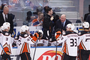 Anaheim head coach Bruce Boudreau speaks to his players during the second period of a NHL hockey game between the Edmonton Oilers and Anaheim Ducks at Rexall Place in Edmonton, Alta., on Friday, Dec. 12, 2014. Ian Kucerak/Edmonton Sun/ QMI Agency