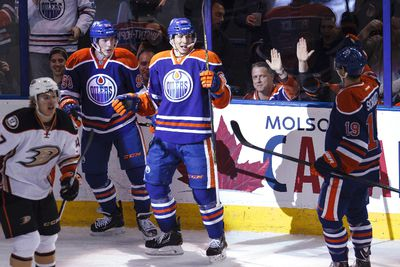 Edmonton forward Tyler Pitlick (68) celebrates his goal with teammates during the second period of a NHL hockey game between the Edmonton Oilers and Anaheim Ducks at Rexall Place in Edmonton, Alta., on Friday, Dec. 12, 2014. Ian Kucerak/Edmonton Sun/ QMI Agency