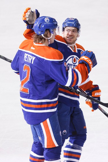 Edmonton defenceman Jeff Petry (2) and defenceman Andrew Ference (21) celebrate Petry's goal against Anaheim during the third period of a NHL hockey game between the Edmonton Oilers and Anaheim Ducks at Rexall Place in Edmonton, Alta., on Friday, Dec. 12, 2014. The Ducks won 4-2. Ian Kucerak/Edmonton Sun/ QMI Agency