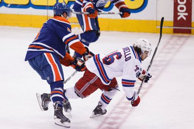 Edmonton forward Taylor Hall (4) and New York forward Mats Zuccarello (36) collide during the third period of a NHL hockey game between the Edmonton Oilers and New York Rangers at Rexall Place in Edmonton, Alta., on Sunday, Dec. 14, 2014. Ian Kucerak/Edmonton Sun/ QMI Agency