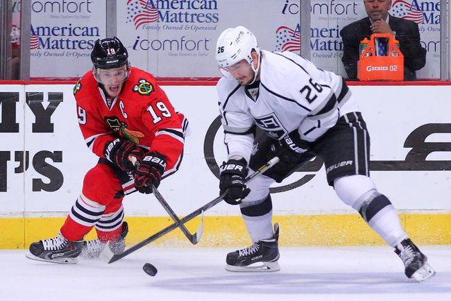 Chicago Blackhawks centre Jonathan Toews (19) steals the puck from Los Angeles Kings defenceman Slava Voynov during Game 7 of the 2014 Western Conference final at the United Center. (Dennis Wierzbicki/USA TODAY Sports)