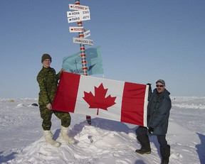 All the way to the North Pole, on the top of the world Bdr. Yannick Tessier and Sgt. Claude Gelinas proudly display Canadian Flag.