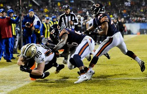 Saints tight end Josh Hill (left) scores a touchdown against Bears inside linebacker Christian Jones (59), cornerback Tim Jennings (26) and free safety Brock Vereen (45) during first half NFL action in Chicago on Monday, Dec. 15, 2014. (Matt Marton/USA TODAY Sports)