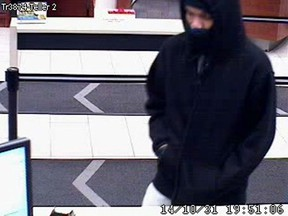 Ottawa cops are seeking this man in connection with a bank robbery at a Towngate shopping centre branch on Oct. 31, 2014. (OTTAWA POLICE Submitted image)
