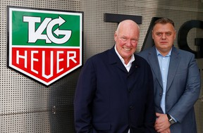 Jean-Claude Biver, head of French luxury goods group LVMH's watch business and interim CEO of the group's biggest watch brand, TAG Heuer, and general manager Guy Semon (R) pose in front of the company's logo in the western Swiss town La Chaux-de-Fonds Dec. 16, 2014.  REUTERS/Arnd Wiegmann