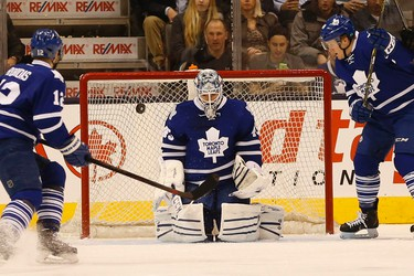 Leafs goalie Jonathan Bernier makes a save but isn;t sure where the puck is. Toronto Maple Leafs vs. Anaheim Ducks. Leafs lead 1-0 at the end of the first period. in Toronto on Tuesday December 16, 2014. Jack Boland/Toronto Sun/QMI Agency