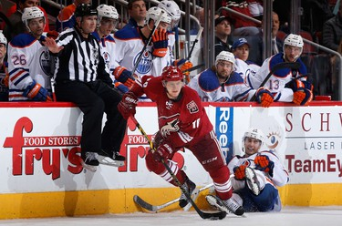 GLENDALE, AZ - DECEMBER 16: Martin Erat #10 of the Arizona Coyotes skates with the puck ahead of Jordan Eberle #14 of the Edmonton Oilers during the overtime period of the NHL game at Gila River Arena on December 16, 2014 in Glendale, Arizona. The Coyotes defeated the Oilers 2-1 in overtime.   Christian Petersen/Getty Images/AFP == FOR NEWSPAPERS, INTERNET, TELCOS & TELEVISION USE ONLY ==