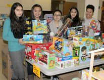Volunteers were at the heart of the Kincardine Christmas Knights campaign on Dec. 13, 2014 at St. Anthony's School, sorting through piles of toys and food collected by local students for the Kincardine Christmas Hamper campaign. Kincardine Christmas Hamper volunteers Raza Hussein, Sofia Tiu, Alessandra Lozada, Sana Hussein and Eliza Bumba show off the piles of toys at St. Anthony's Church on Dec. 13, 2014, donated throughout the community for families in need this Christmas. (TROY PATTERSON/KINCARDINE NEWS)