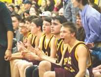 The PCI Trojans boys varsity basketball team react to a basket late in the fourth quarter during their win season opening win over the St. James Jimmies on Dec. 15 at PCI. (MattHermiz/TheGraphic/QMIAgency)